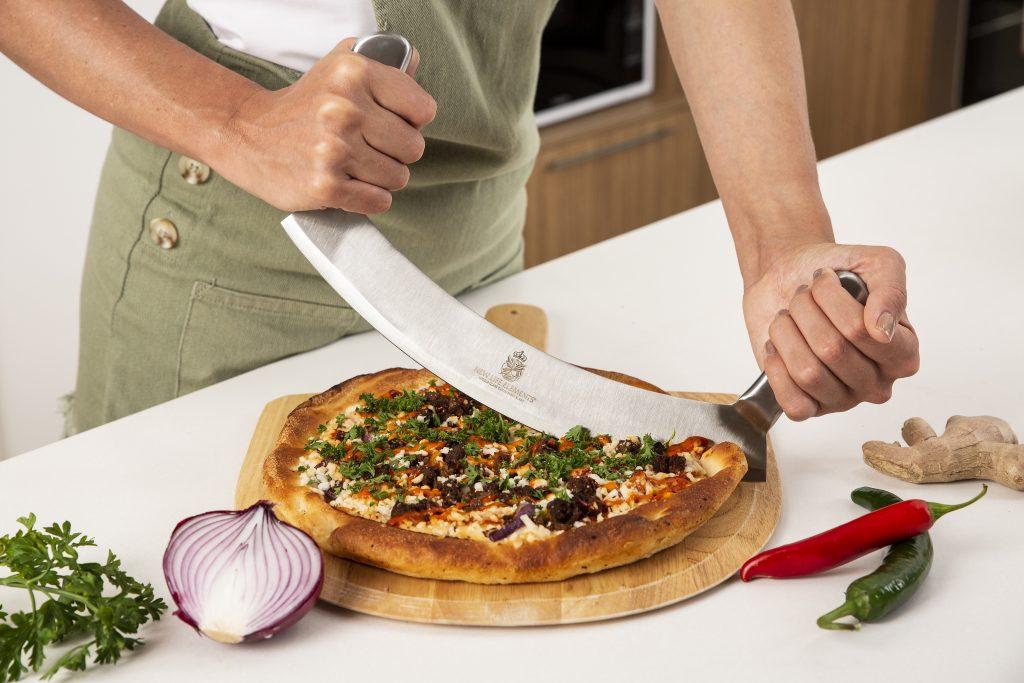 Get your Pizza Cutter,Mezzaluna knife or Rocker knife.